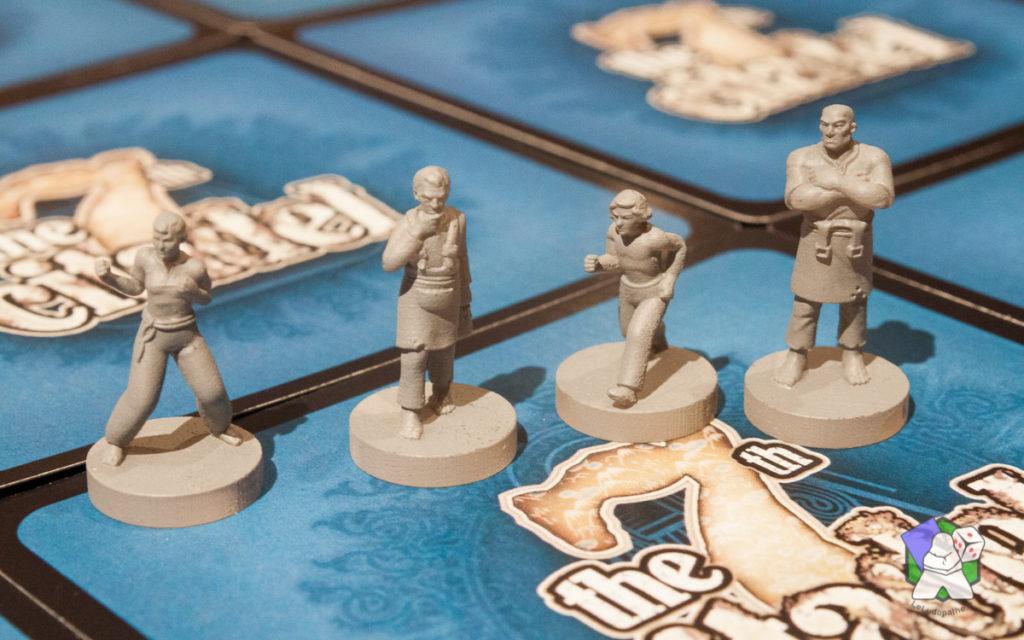 4 figurines du prototype, sur les 8 du jeu final